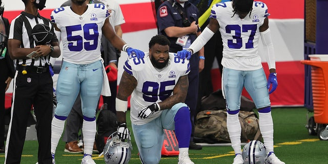 Dallas Cowboys defensive tackle Dontari Poe (95) kneels during the national anthem prior to the game against the Atlanta Falcons at AT&T Stadium. (Matthew Emmons-USA TODAY Sports)