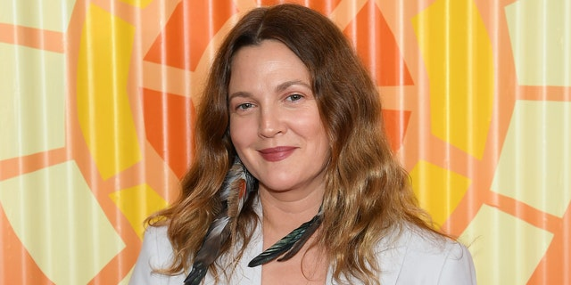 Drew Barrymore is part of the legendary Barrymore family, which included her estranged father, John. She was emancipated from her parents by the age of 14. (Dimitrios Kambouris/Getty Images for The Charlize Theron Africa Outreach Project)