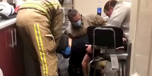 Firefighters sent three firefighters to help free Cole, 21, from the dryer.