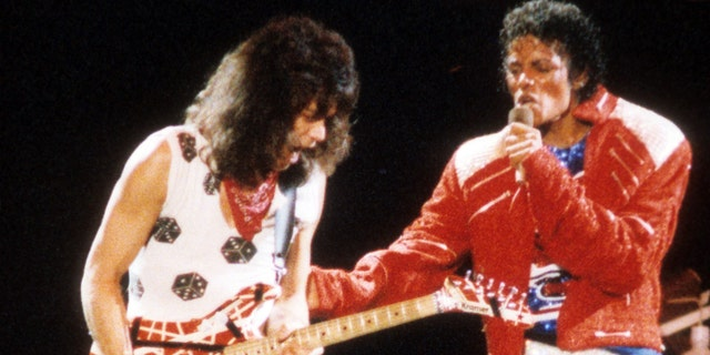 "Guitarist Eddie Van Halen joins pop star Michael Jackson on stage to perform his hit song ""Beat It"" during The Jacksons Victory Tour on July 14, 1984 at Texas Stadium in Dallas. (Getty Images)"