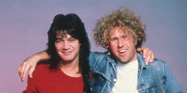 """Dutch-American lead guitarist and songwriter Eddie Van Halen and American rock vocalist, songwriter and entrepreneur Sammy Hagar, of the hard rock band Van Halen, backstage during their """"5150"""" tour, on May 9, 1986, at the Joe Louis Arena in Detroit, Michigan. (Photo by Ross Marino/Getty Images)"""