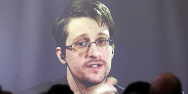 Edward Snowden speaks via video link during a conference at University of Buenos Aires Law School, Argentina.