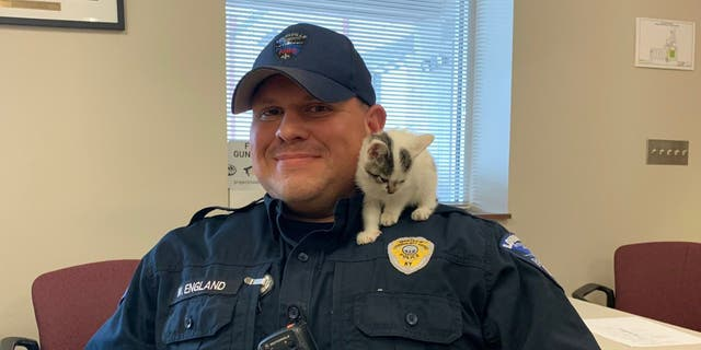 Public Safety Office Wes England and Bo the kitten. (Louisville Muhammad Ali International Airport)