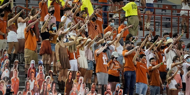 """In this Saturday, Sept. 12, 2020, file photo, fans join in singing """"The Eyes of Texas"""" after Texas defeated UTEP 59-3 in an NCAA college football game in Austin, Texas. (AP Photo/Chuck Burton, File)"""
