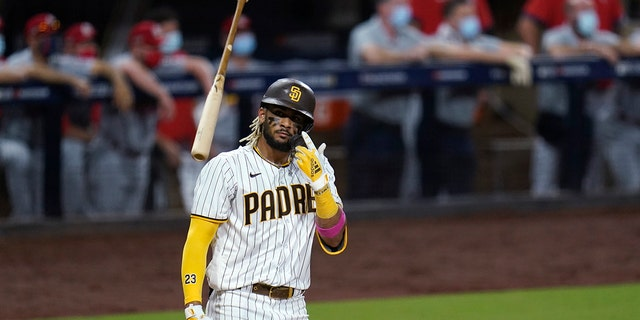 San Diego Padres' Fernando Tatis Jr. tosses his bat after hitting a two-run home run during the seventh inning of Game 2 of the team's National League wild-card baseball series against the St. Louis Cardinals, Thursday, Oct. 1, 2020, in San Diego. (AP Photo/Gregory Bull)