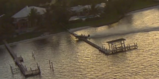 The out-of-control boat made a crash landing after going airborne over a dock in Stuart, Fla. on Friday.