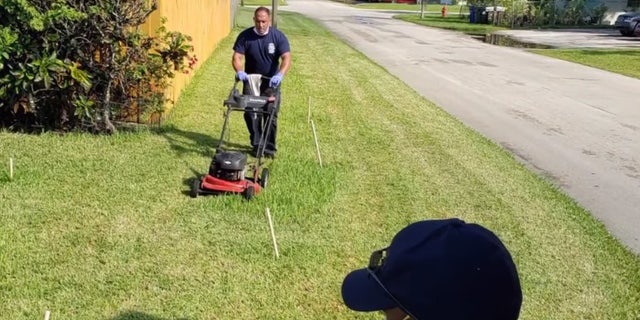 First responders from Fort Lauderdale Fire Rescue cut Prince Pinkney's grass after he was treated for heat exhaustion.