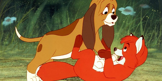 """A rescue fox and a bulldog have made the 1981 animated movie """"The Fox and the Hound"""" (pictured) come to life in the Isle of Wight in England."""