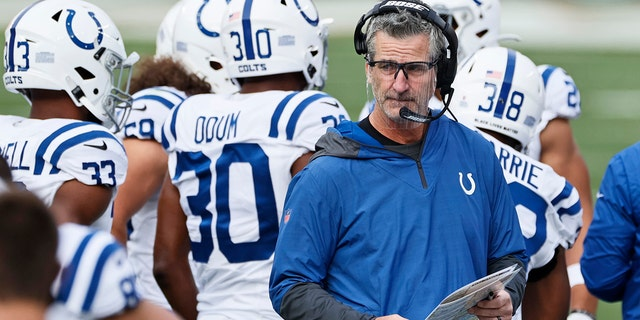 Indianapolis Colts head coach Frank Reich keeps watch during the first half of an NFL football game against the Cleveland Browns, Sunday, Oct. 11, 2020, in Cleveland. (AP Photo/Ron Schwane)