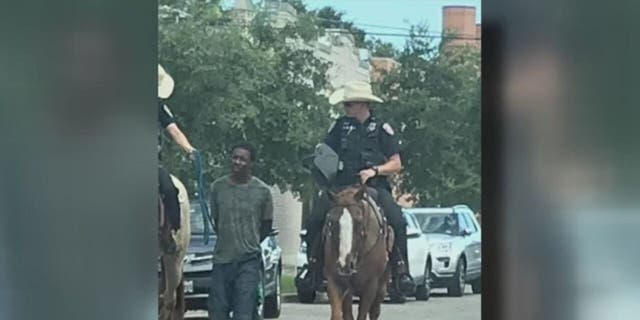 Donald Neely, 44, was arrested for criminal trespassing in August 2019 before two mounted Galveston police officers handcuffed him and led him by rope down several city blocks. (Handout)