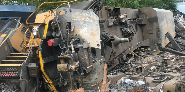A freight train derailed early Sunday in Lilburn, Ga., sparking a small fire and triggering evacuations in one neighborhood.