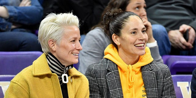 USWNT forward Megan Rapinoe, left, and Seattle Storm guard Sue Bird enjoy a game at the Alaska Airlines Arena on January 27, 2019 in Seattle, Washington. (Getty Images)