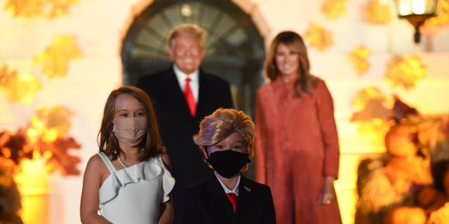 """The president is said to have been """"particularly pleased"""" with two youngsters dressed as the first couple, pictured.(Olivier Douliery/AFP via Getty Images)"""