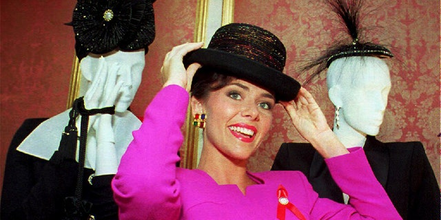 Miss America 1993 Leanza Cornett tries on a hat in New York.