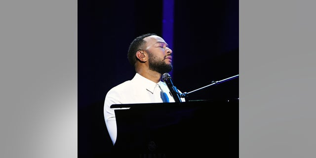 John Legend performs onstage at the 2020 Billboard Music Awards. (Photo by Kevin Winter/BBMA2020/Getty Images for dcp)