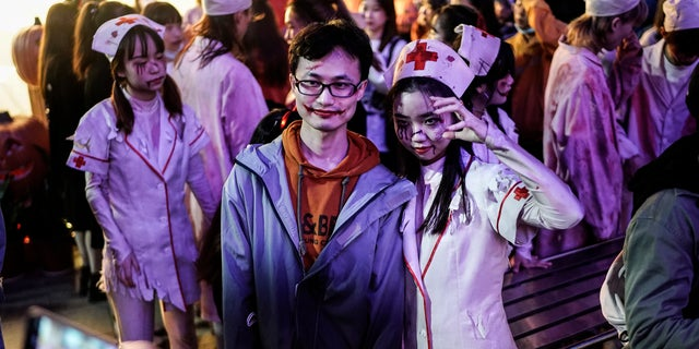 People dressed in Halloween-themed costumes participate in a parade event celebrating Halloween at the Happy Valley on October 29, 2020, in Wuhan, Hubei province, China. (Photo by Getty Images)