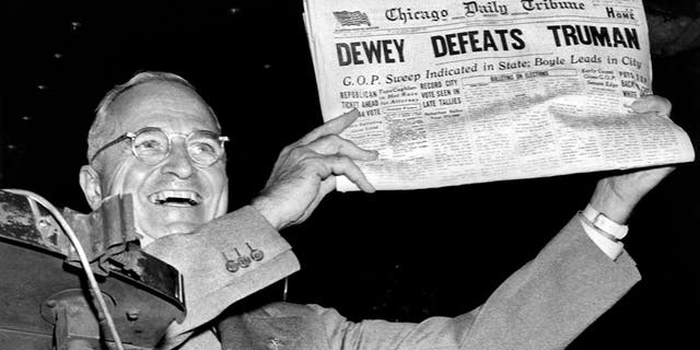 President Harry Truman holds up a copy of the Chicago Daily Tribune wrongly declaring his defeat to Thomas Dewey in the presidential election, St Louis, MIssouri, November 1948. (Photo by Underwood Archives/Getty Images)