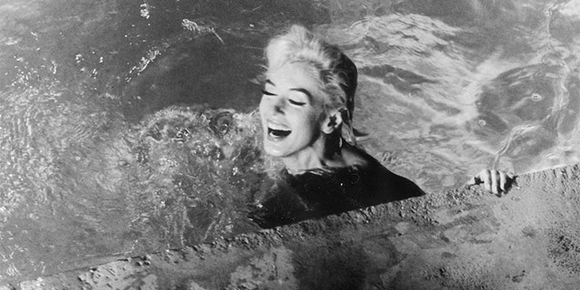 Marilyn Monroe, playing Ellen Arden, swims naked in 1962's 'Something's Got to Give.' The movie was never completed due to Monroe's sudden death during production.
