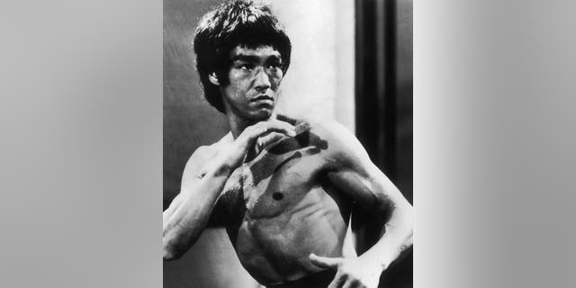 Chinese-American martial arts exponent Bruce Lee (1940 - 1973), in a still from the film 'Enter The Dragon', directed by Robert Crouse for Warner Brothers, 1973.