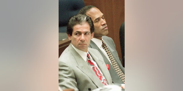 Murder defendant O.J. Simpson (R) listens to testimony by the Los Angeles County Coroner 07 June on how his ex-wife, Nicole Brown Simpson, died of a deep slashing wound to her neck. The Coroner detailed how he estimated that a 6-inch knife was used to cut her neck almost to the spinal column. Next to Simpson is attorney Robert Kardashian.