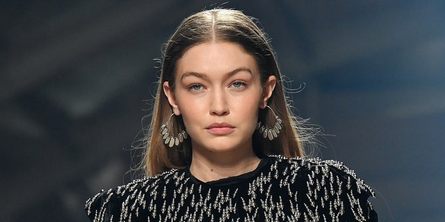 Gigi Hadid encouraged fans to vote in a recent Instagram post. (Photo by Stephane Cardinale - Corbis/Corbis via Getty Images)