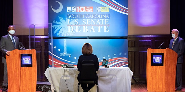 Democratic challenger Jaime Harrison, left, and U.S. Sen. Lindsey Graham, right, R-S.C., face off in the South Carolina U.S. Senate debate at Allen University in Columbia, S.C., Saturday, Oct. 3, 2020. (Associated Press)