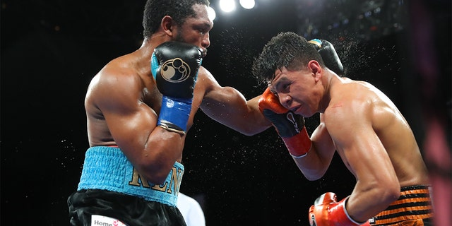 Tureano Johnson (大号) exchanges punches with Jaime Munguia ([R) at Fantasy Springs Casino on October 30, 2020, in Indio, 加利福尼亚州. (Photo By Tom Hogan/Golden Boy/Getty Images)