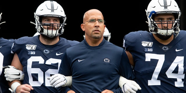 FILE - In this Saturday, Sept. 14, 2019 file photo, Penn State head coach James Franklin leads his team onto the field for an NCAA college football game against Pittsburgh in State College, Pa. (AP Photo/Barry Reeger, File)