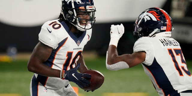 Denver Broncos wide receiver Jerry Jeudy (10) celebrates with K.J. Hamler (13) after scoring a touchdown during the first half of the team's NFL football game against the New York Jets on Thursday, Oct. 1, 2020, in East Rutherford, N.J. (AP Photo/Seth Wenig)