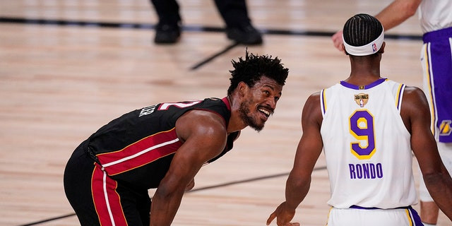 Miami Heat's Jimmy Butler (22) and Los Angeles Lakers' Rajon Rondo (9) laugh during the second half in Game 3 of basketball's NBA Finals, Sunday, Oct. 4, 2020, in Lake Buena Vista, Fla. (AP Photo/Mark J. Terrill)