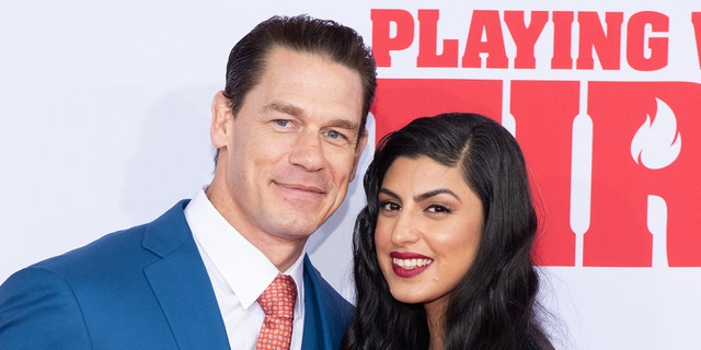 John Cena (left) and Shay Shariatzadeh married in Florida this week. (Photo by Noam Galai/Getty Images)