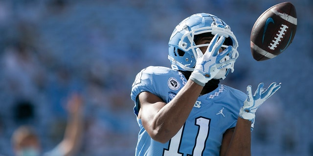 North Carolina's Josh Downs scores on a 17-yard pass from quarterback Sam Howell in the third quarter of an NCAA college football game against North Carolina State, Saturday, Oct. 24, 2020, in Chapel Hill, N.C. (Robert Willett/The News & Observer via AP)