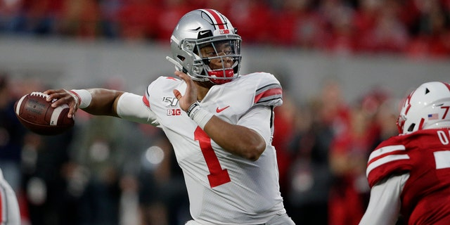 FILE - In this Saturday, Sept. 28, 2019, file photo, Ohio State quarterback Justin Fields (1) throws a pass during the first half of an NCAA college football game against Nebraska in Lincoln, Neb. Ohio State hosts Nebraska on Saturday, Oct. 24, 2020. (AP Photo/Nati Harnik, File)