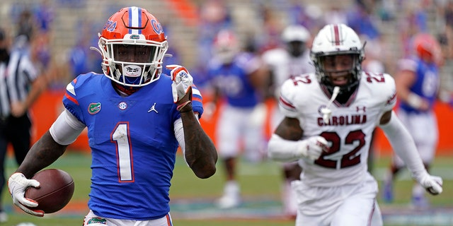 Florida wide receiver Kadarius Toney (1) gets past South Carolina defensive back John Dixon (22) for a 57-yard touchdown run during the second half of an NCAA college football game, Saturday, Oct. 3, 2020, in Gainesville, Fla. (AP Photo/John Raoux, Pool)