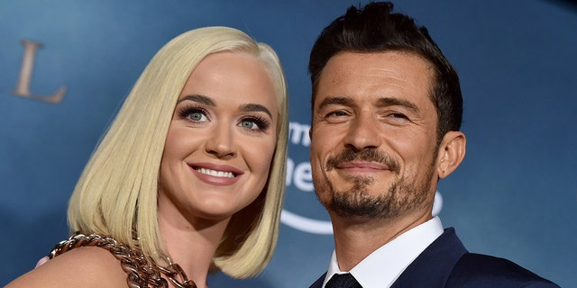 Katy Perry and Orlando Bloom made up a song encouraging fans to vote in-person. (Axelle/Bauer-Griffin/FilmMagic)