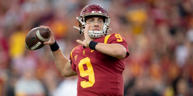 In this Nov. 2, 2019 file photo, Southern California quarterback Kedon Slovis throws a pass during the first half of an NCAA college football game against Oregon in Los Angeles. (AP Photo/Kyusung Gong, File)