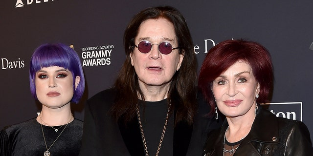 Sharon Osbourne (right) with her husband Ozzy Osbourne (center) and daughter Kelly Osbourne (left). (Photo by Axelle/Bauer-Griffin/FilmMagic)