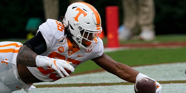 Tennessee linebacker Kivon Bennett (95) recovers a Georgia fumble in the end zone for a touchdown in the first half of an NCAA college football game Saturday, Oct. 10, 2020, in Athens, Ga. (AP Photo/John Bazemore)