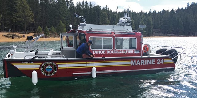 A woman drowned in Lake Tahoe late Friday and 6 children were rescued from a boat that drifted away after their father jumped in to help.