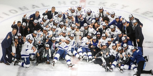 Tampa Bay Lightning players celebrate their Stanley Cup win over the Dallas Stars at the NHL Stanley Cup hockey finals in Edmonton, Alberta, on Monday, Sept. 28, 2020. (Jason Franson/The Canadian Press via AP)