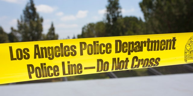 Yellow tape surrounds a crime scene in Los Angeles.