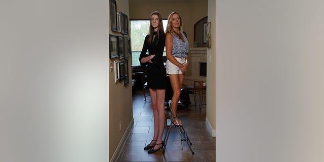 """""""I was never bullied for my legs... I was bullied because I was taller than everyone,"""" said Currin, seen here with mom Trish."""
