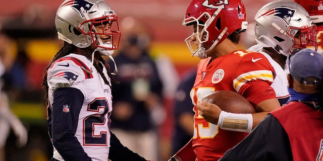 New England Patriots cornerback Stephon Gilmore, left, talks with Kansas City Chiefs quarterback Patrick Mahomes after an NFL football game, Monday, Oct. 5, 2020, in Kansas City. The Chiefs won 26-10. (AP Photo/Charlie Riedel)