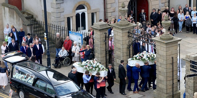 The coffins of Chloe Rutherford and Liam Curry, who were killed in the Manchester Arena bombing, arrive at St Hilda's Church, for their funeral service in South Shields, South Tyneside, Britain June 15, 2017. REUTERS/Danny Lawson/Pool