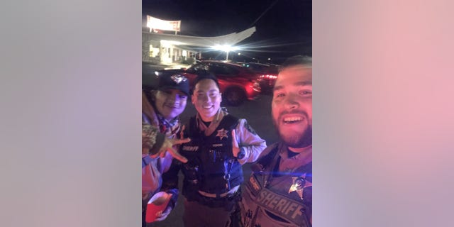 Marvin and two Oregon law enforcement officers who helped him safely get home, pictured.
