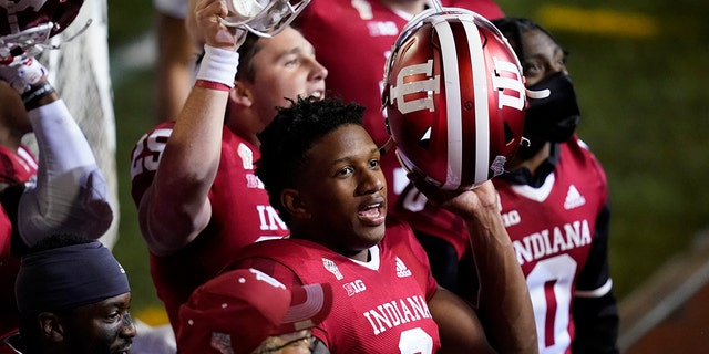 Indiana quarterback Michael Penix Jr. (9) celebrates after Indiana defeated Penn State in overtime of an NCAA college football game, Saturday, Oct. 24, 2020, in Bloomington, Ind. Indiana won 36-35. (AP Photo/Darron Cummings)