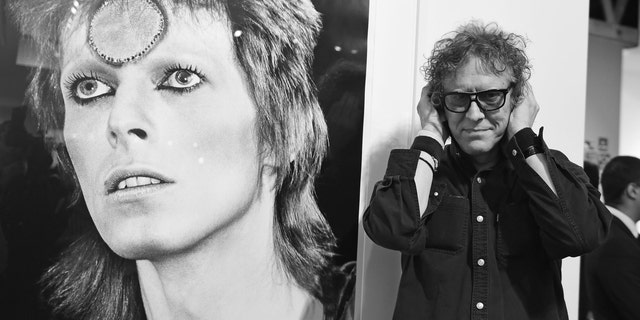 Photographer Mick Rock (right) spoke to Fox News about his time photographing David Bowie (left). (Angela Weiss/Getty Images)