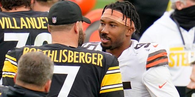Pittsburgh Steelers quarterback Ben Roethlisberger (7) and Cleveland Browns defensive end Myles Garrett (95) meet on the field following an NFL football game in Pittsburgh, Sunday, Oct. 18, 2020. (AP Photo/Gene J. Puskar)