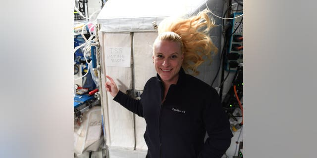 NASA astronaut Kate Rubins outside the voting booth on the International Space Station. (NASA)