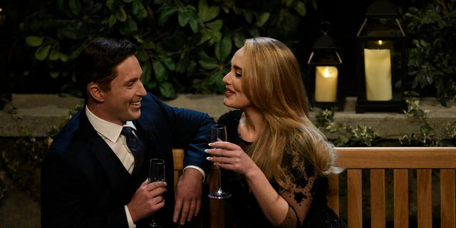 From l-r: Beck Bennett as Ben K and host Adele as herself during 'The Bachelor' sketch.